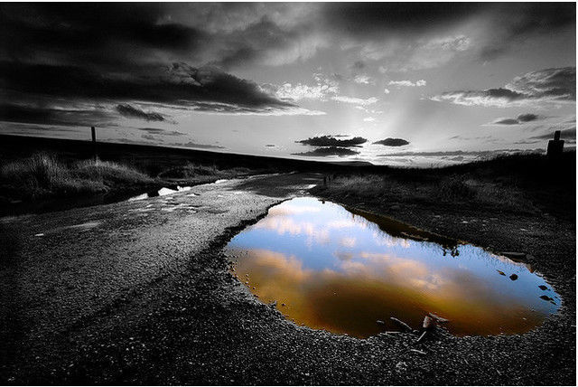 Black and white photograph and adding partial color effects sunset after the rain selective colour