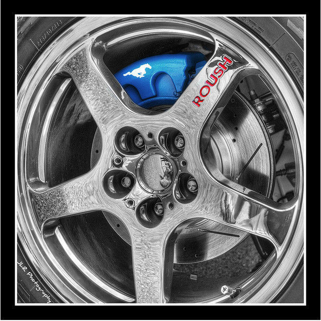 black and white photograph and adding partial color effects Rim & Caliper on 427R Roush Mustang