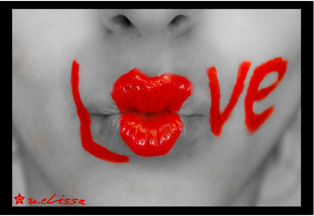 Black and white photograph and adding partial color effects kiss kiss love