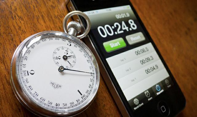 vintage stopwatch next to iPhone stopwatch app