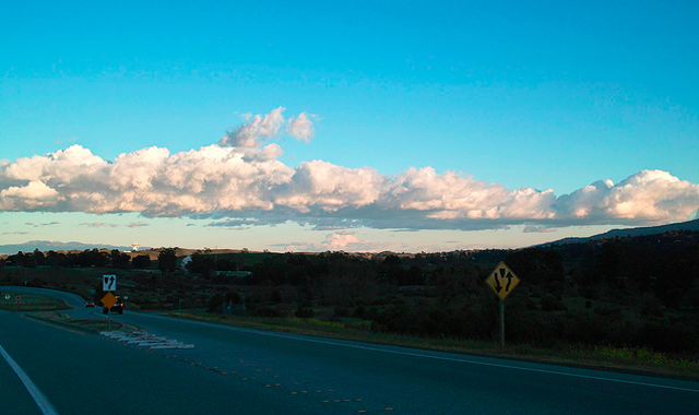 clouds above highway driving - San Francisco, CA, USA