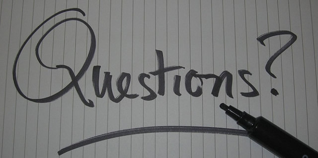 the word questions written with a sharpie on lined paper