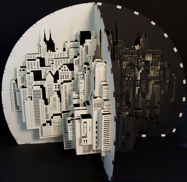 papercraft sculpture of a fold out cityscape by Ingrid Siliakus