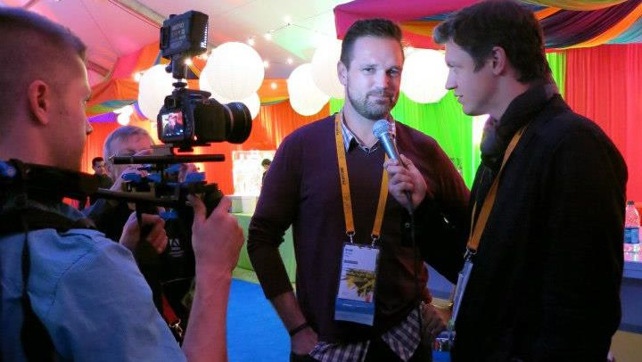Brent Weaver interviews attendee at Adobe MAX 2013