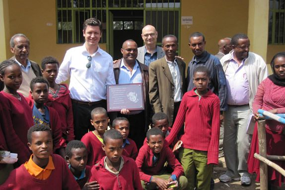 Brent Weaver presents donor plaque to library in rural Ethiopia