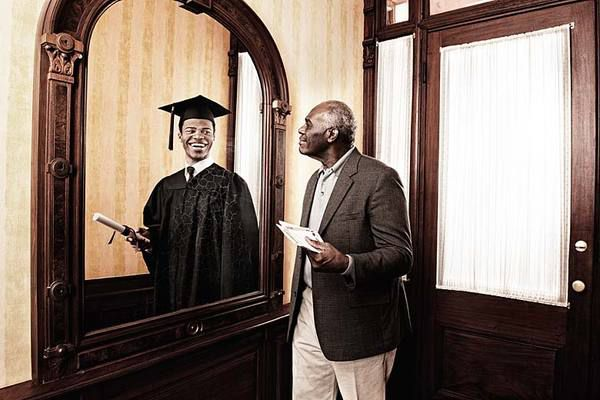 older man looking in mirror and seeing reflection of his younger self as a student