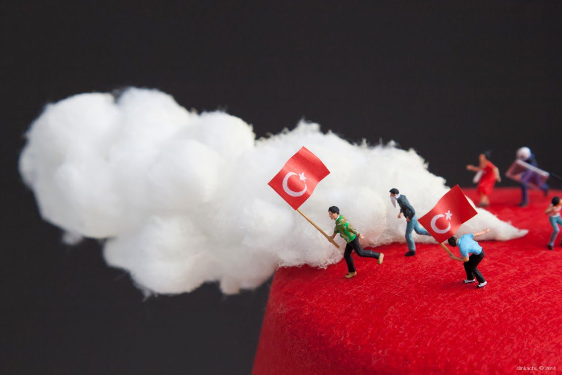photographs miniature human figurines Fez Protests in Turkey