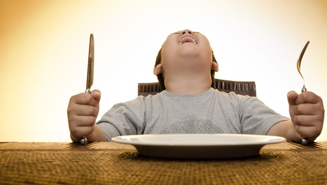 boy screaming on dining table waiting for food