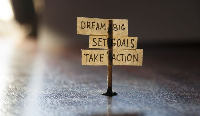 Dream Big, Set Goals, Take Action, concept, tags on the table