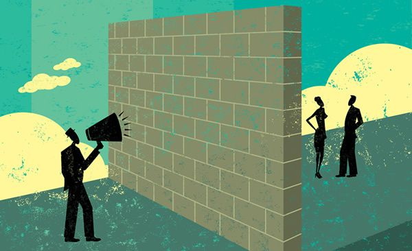 shouting at a brick wall which represents a barrier to his ability to reach potential clients