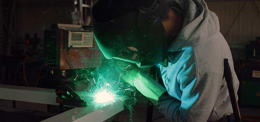 Factory worker welding.