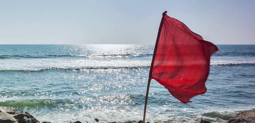 red flag warning beach sea