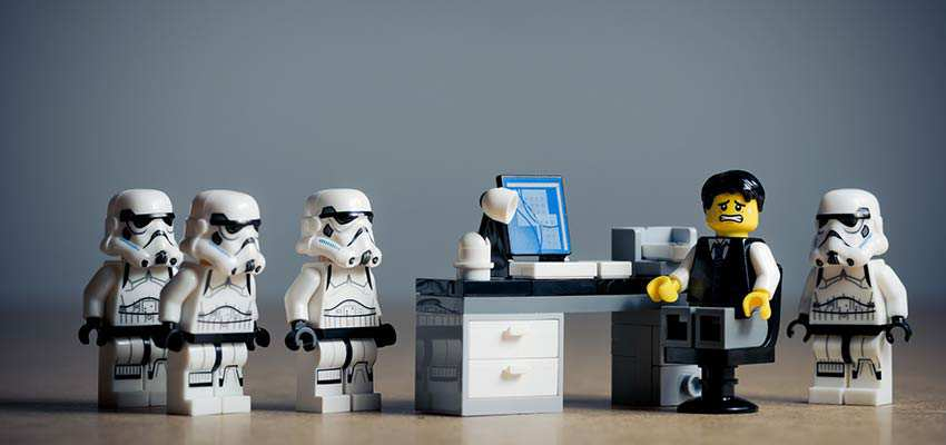Office worker surrounded by Storm Troopers