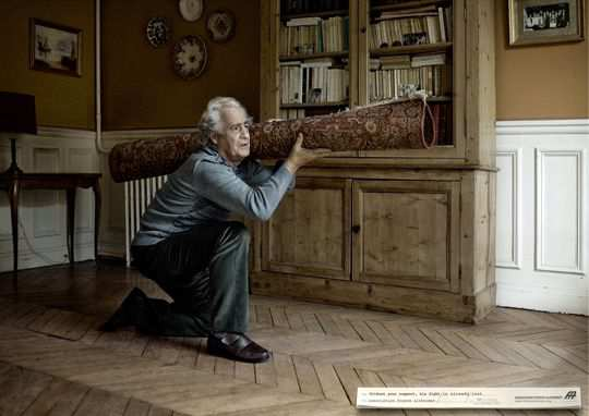 Print Ad - Old Man Carrying a Bazooka Carpet