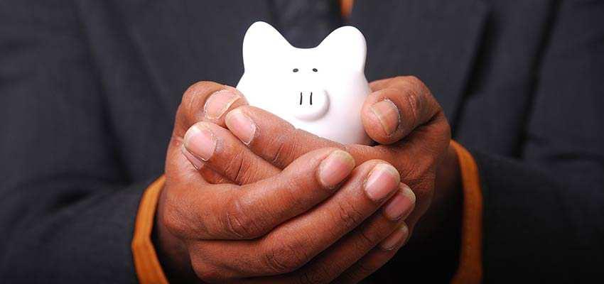 Man holding a piggy bank.