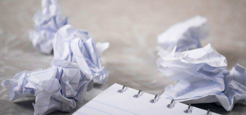 Crumpled notebook paper on a desk.