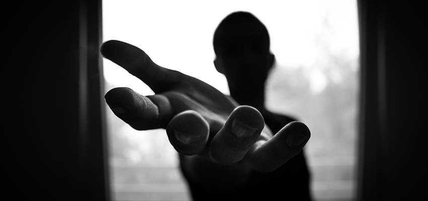A person with a hand reaching out.