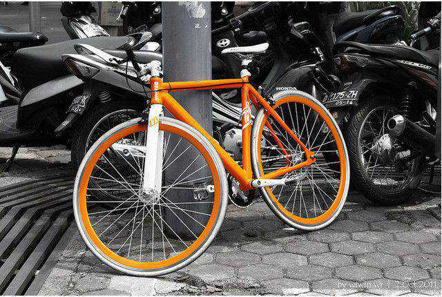 b and w shot coloring Orange bicycle