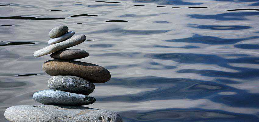 Stones balanced over water.