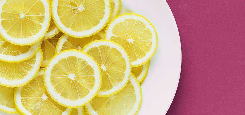 Slices of lemon on a plate.