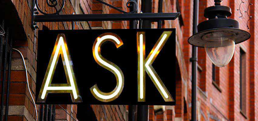 "A building sign that reads ""ASK""."