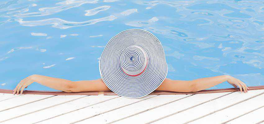 A woman relaxing in a swimming pool.