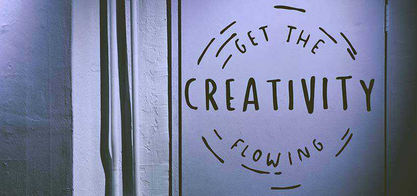 """A poster that reads, """"Get the Creativity Flowing""""."""