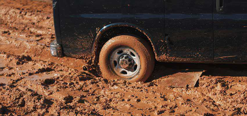 A vehicle stuck in mud.