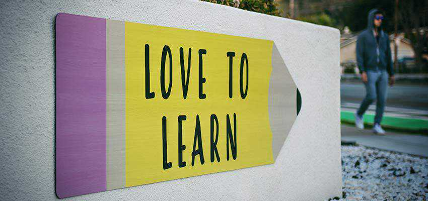 "A sign that reads ""Love To Learn""."