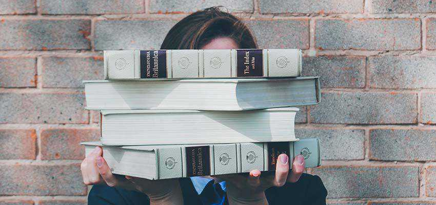 A person holding books.