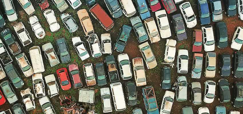 Vehicles in a junk yard.