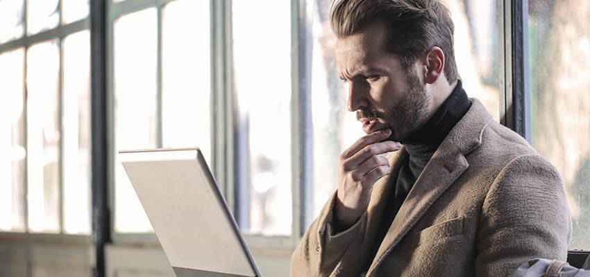 Man looking at a laptop computer.