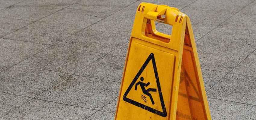 Slippery when wet warning sign.