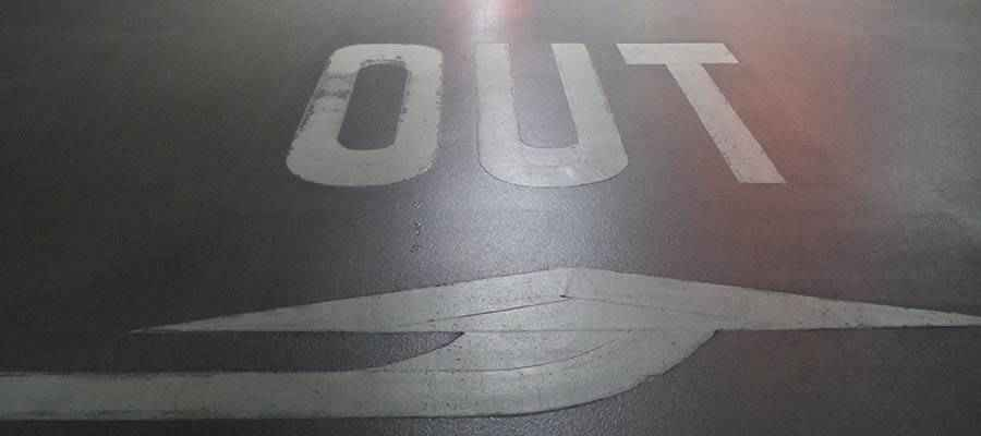 "The word ""OUT"" painted on a road."