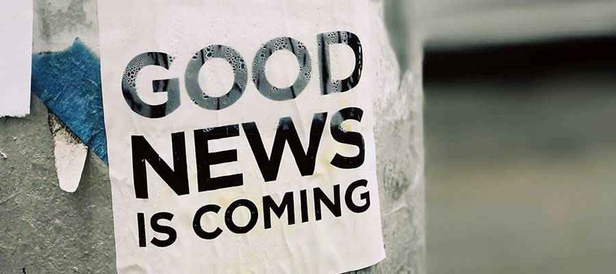 "A sign that reads: ""Good News is Coming""."