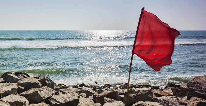 red flag stormy sea