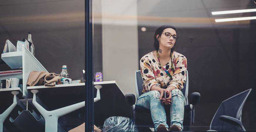Woman window working looking out work bored