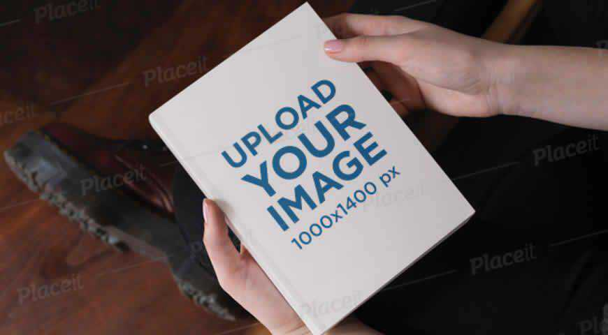 Woman Holding a Hardcover Book Photoshop PSD Mockup Template