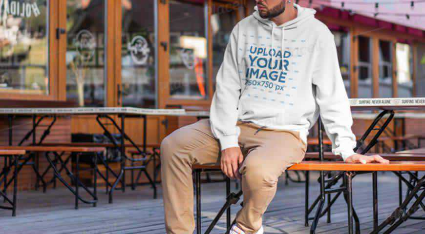 Man Wearing Hoodie in Restaurant Photoshop PSD Mockup Template