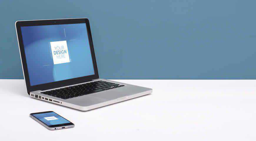 Laptop and Smartphone on White Desk with Blue Background Photoshop PSD Mockup Template