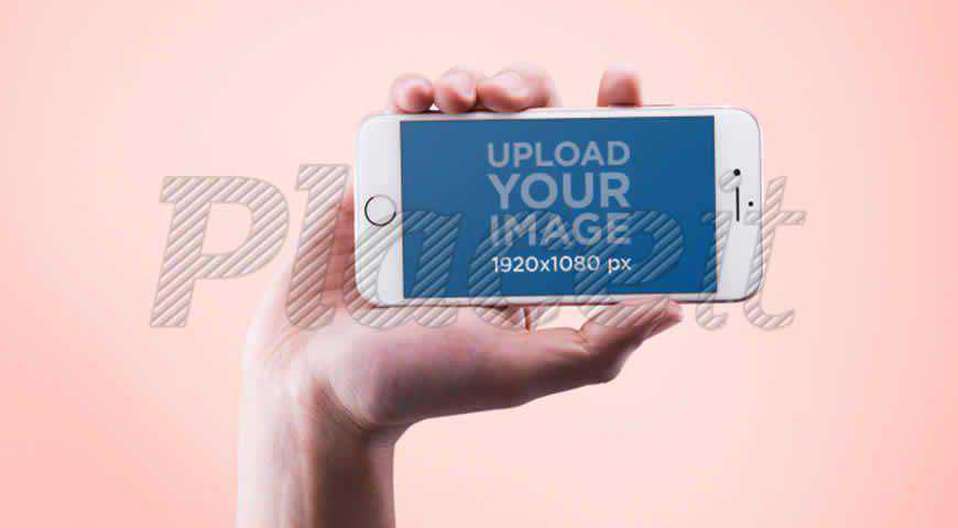 Hand Holding an iPhone in Landscape Photoshop PSD Mockup Template