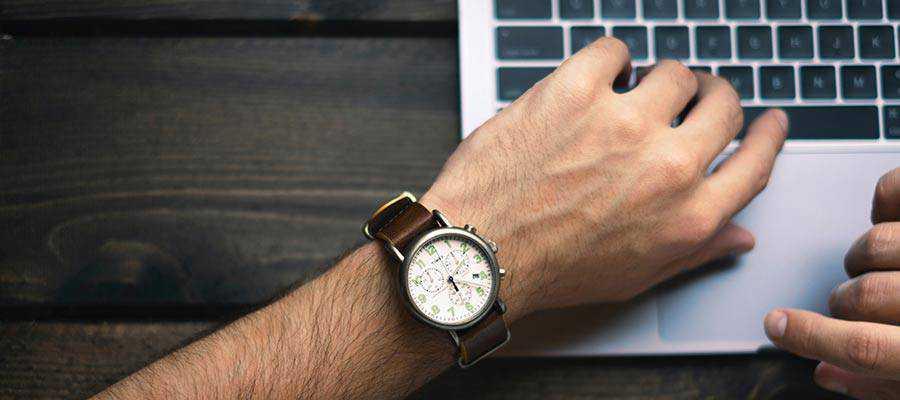 A person wearing a wristwatch.