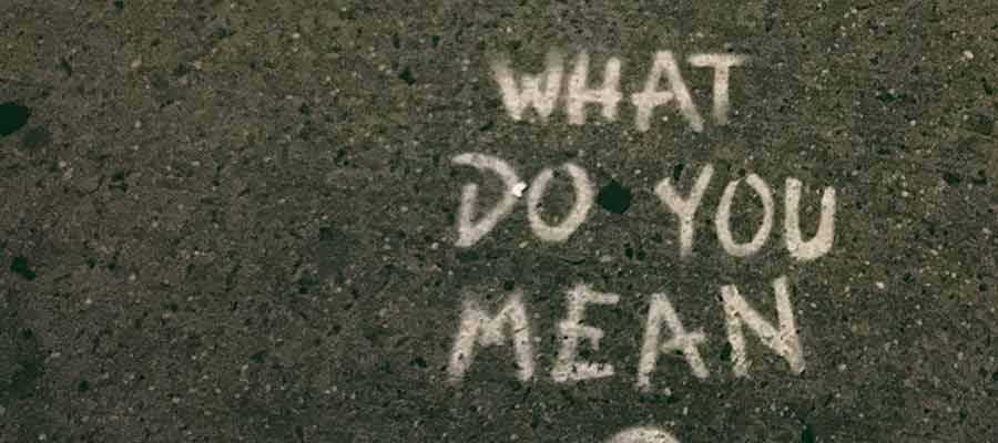 "The words ""What Do You Mean"" written on a sidewalk."