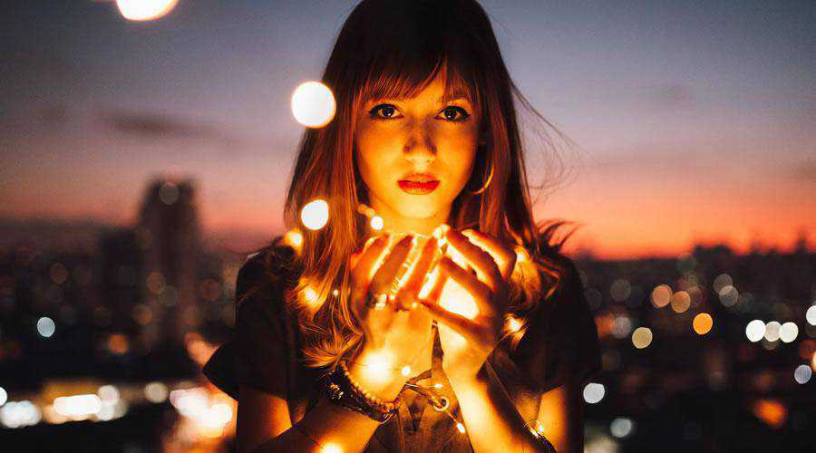 Woman Holding Fireflies lights bokeh photography inspiration