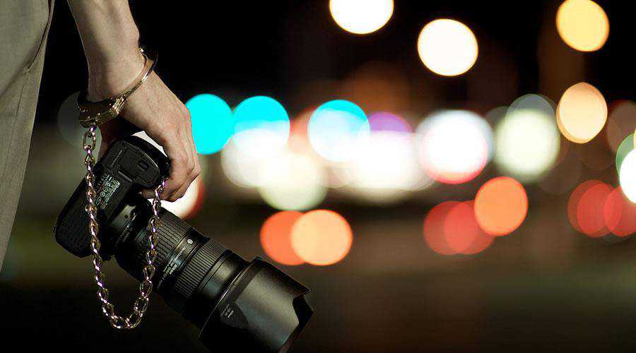Photographer at Night lights bokeh photography inspiration