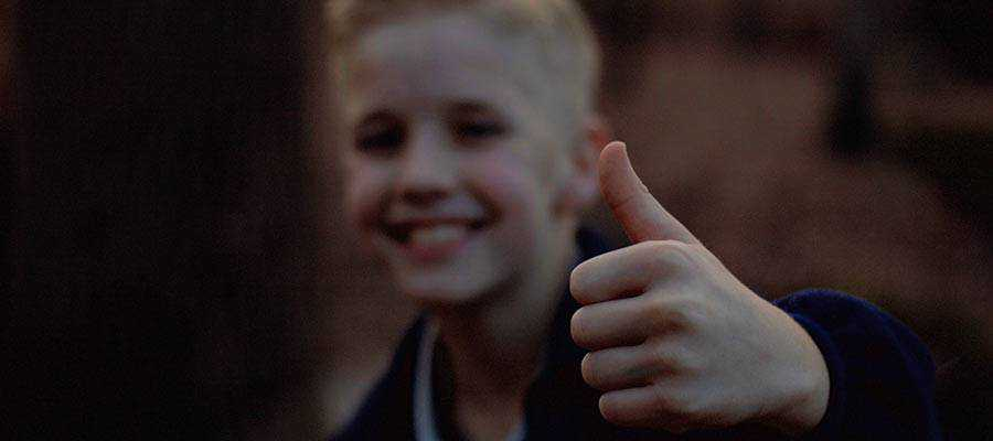 A person giving a thumbs up sign.