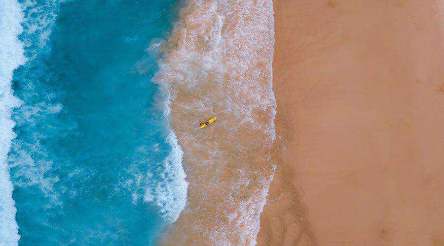 Drone View of Sandy Beach & Blue Ocean desktop wallpaper hd 4k high-resolution