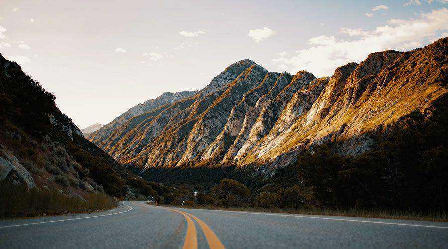 Road Winding Through Mountains desktop wallpaper hd 4k high-resolution