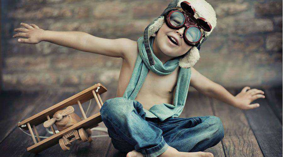 Happy Young Boy Playing With Toy Plane desktop wallpaper hd 4k high-resolution