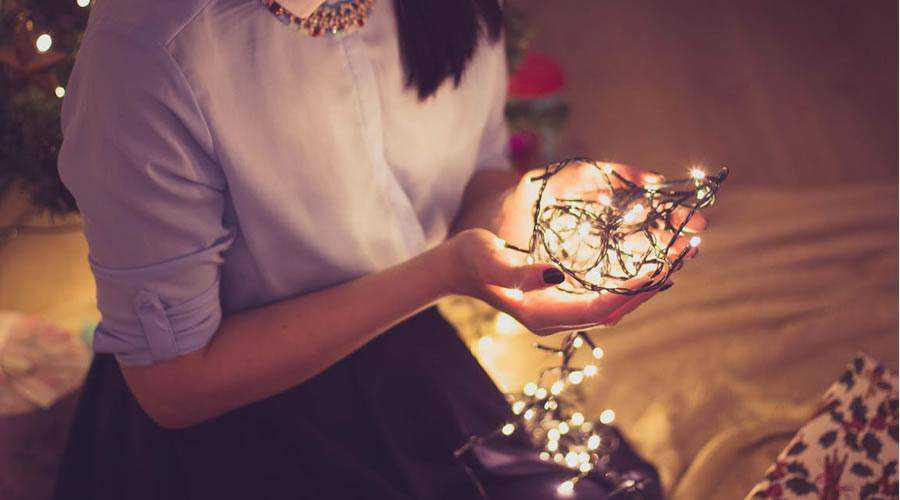 Woman Holding Christmas Lights hd wallpaper desktop high-resolution background
